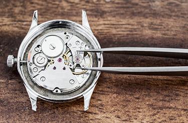 時計修理業者と提携