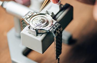 時計の修理工房と提携