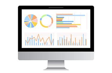 相場のグラフを表示したパソコン